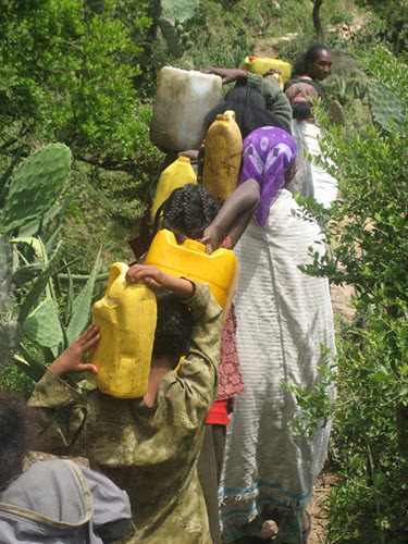Women carrying unsafe water home.jpg